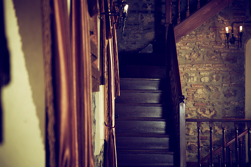 181895043-wooden-stairs-restored-victorian-style-home-gettyimages